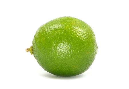 Fresh limes isolated on white Foto de archivo