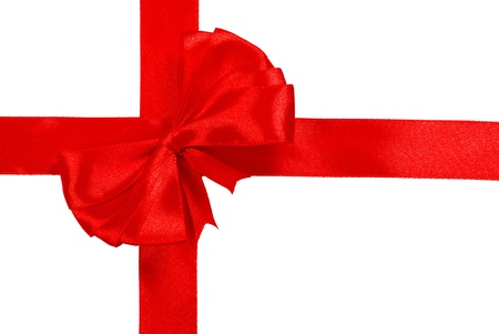 Red satin ribbon with bow isolated over white background photo