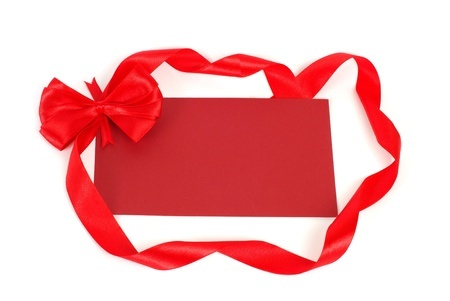 Blank gift tag tied with a bow photo