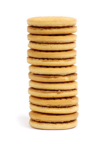 Stacks of cookies on white background photo