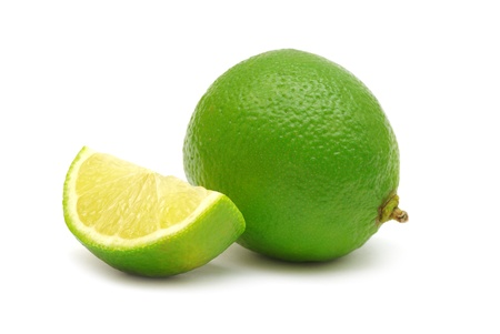 Fresh limes isolated on white Standard-Bild