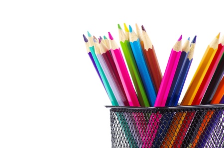 A stack of colored pencils on white background photo
