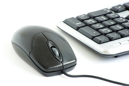 computer mouse and keyboard isolated on white photo