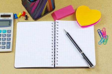 Notebook  and pen on wooden table photo