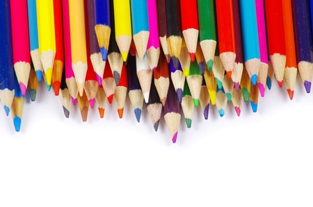 stack of colored pencils on white background photo