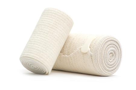 medical bandage roll on white Foto de archivo