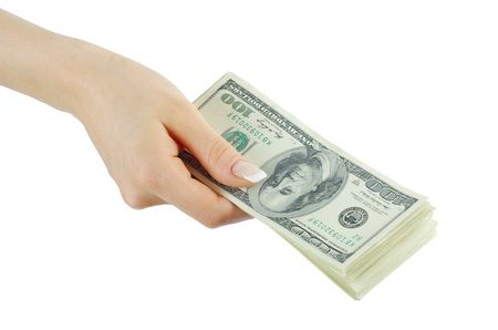 Hand with money isolated on white background photo