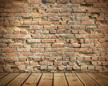 wood wall texture: interior with an old brick wall and wooden floor Stock Photo