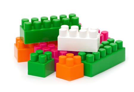 yellow lego block: plastic construction on white background Stock Photo