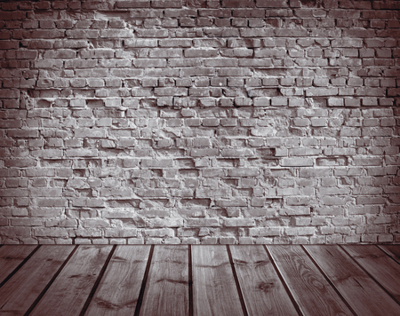 empty warehouse: interior with an old brick wall and wooden floor Stock Photo
