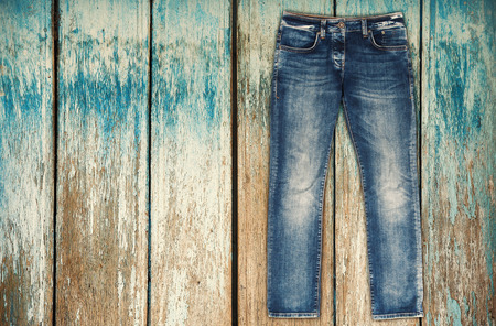 trouser: Blue jeans trouser over white wood planks background