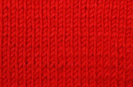 Red woolen texture background photo