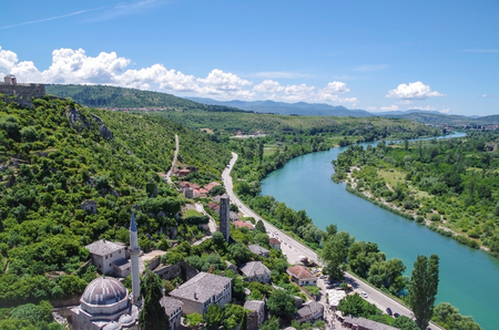 balkans: Scenic view of the mosque, tower, medieval fortress wall, valley and the river Naretva from Citadel Pocitelj. Nature and travel. Bosnia and Herzegovina, Pocitelj