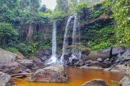 Waterfall on the Siem Reap River. Phnom Kulen - the sacred mountain in Cambodia, the top of the mountain is the sacred place for Hindus and Buddhists. Cambodia, near Angkor, Phnom Kulen National Park