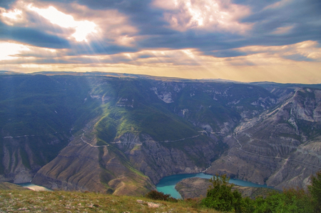 dagestan: Beautiful sunset landscape in exclusive beauty a Sulaksky Canyon. The deep valley of the green-blue river with very steep slopes and a narrow bottom. One of the largest canyons in the world on depth. Nature and travel. Russia, Dagestan, Caucasus Mountains