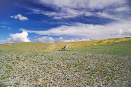 Mongolian Altai. Mountain pass. Sacred stone heaps (ovoo, oboo or obo). Altars or shrines in Mongolian folk religious practice. Sites for the worship. Nature and travel. Mongolia, Bayan-Olgii Province