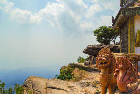 Scenic view from Bokor mountain on the coast of gulf of Siam - a coastal line of Kampot. Lion and naga at an entrance to pagoda. Cambodia, Preah Monivong Bokor National Park Stock Photo