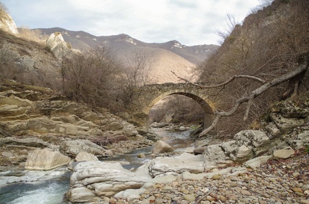 Stone arch bridge and the river. Nature and travel. Russia, North Caucasus, Dagestan, Tabasaransky District Stok Fotoğraf