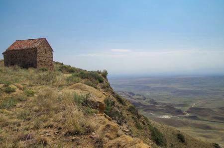 Monastery on the half-desert slope of Mount Gareja. Georgian Orthodox monastery complex. David Gareja. Georgia, Kakheti region, Georgia and Azerbaijan Stok Fotoğraf