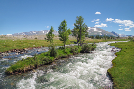 Mongolian Altai. Beautiful view of the raging mountain river. High water. Spring run-off. Nature and travel. Mongolia, Bayan-Olgii Province, Altai Tavan Bogd National Park
