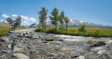 Mongolian Altai. Scenic view of the raging mountain river. High water. Spring run-off. Nature and travel. Mongolia, Bayan-Olgii Province, Altai Tavan Bogd National Park Stok Fotoğraf