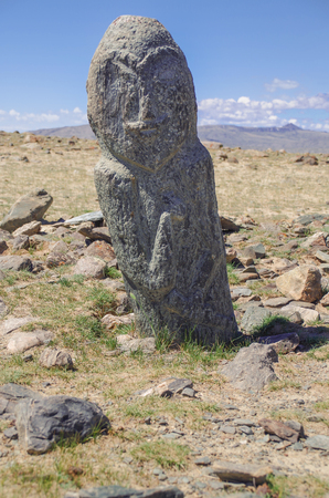 Mongolian Altai. Past civilizations. Turkic stone warrior with a rough image of a human face (Balbal). Nature and travel. Mongolia, Bayan-Olgii Province, Altai Tavan Bogd National Park