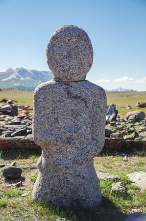 Mongolian Altai. Past civilizations. Turkic Stone Man. Turkic stone warrior (Kurgan stelae or Balbal). Mongolia, Bayan-Olgii Province, Altai Tavan Bogd National Park, near Khurgan Lake, Shar Bulag