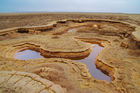 Extraterrestrial landscape. Bizarre land formations. Petroleum lake with geysers near volcano Dallol. Hottest place on Earth. Nature and travel. Ethiopia, Danakil Depression (Afar Triangle