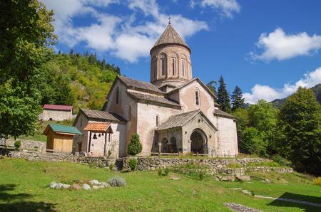 Timotesubani is a medieval Georgian Orthodox Christian monastic complex. The church is built of pink stone. Georgia, Samtskhe-Javakheti region, Borjomi Gorge Stok Fotoğraf