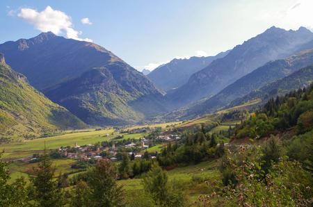 Scenic autumn landscape in the Caucasus. Svan Towers. Nature and travel. Georgia, Svaneti region Stok Fotoğraf