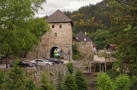 Southern gate (Travnicka kapija) of walled medieval city of Jajce. First, gate was cut through for fortification. High tower over gate was constructed later. Bosnia and Herzegovina