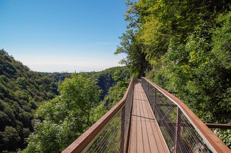 Metal footbridge over an abyss. Okatse Canyon Natural Monument. Georgia, Imereti region, near Kutaisi