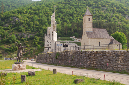 Podmilacje, Jajce, Bosnia and Herzegovina - Jun 11, 2016: Place it in Bosnia and Herzegovina. Sculpture of John the Baptist. Two churches - old gothic and new ultramodern.