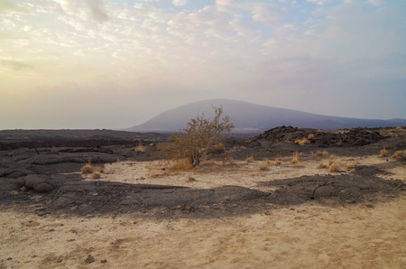 Sunrise. Beautiful view of stratovolcano Ale Bagu. Trek from Erta Ale across lava field to base camp. Ethiopia, Afar Depression (Afar Triangle or Danakil Depression)