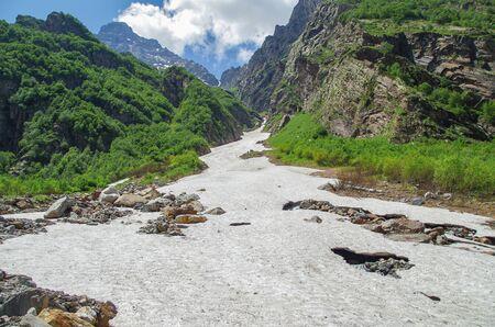 Dombay. Trek to Sofrudzhu Falls. Beautiful view of the snowfields and mountains. Nature and travel. Russia, North Caucasus, Karachay-Cherkessia Stok Fotoğraf