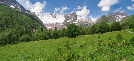 Dombay. Trek to Alibek Fall. Scenic view of Herzog (3863 m) and Alibek glacier. Nature and travel. Russia, North Caucasus, Karachay-Cherkessia, Teberda Nature Reserve