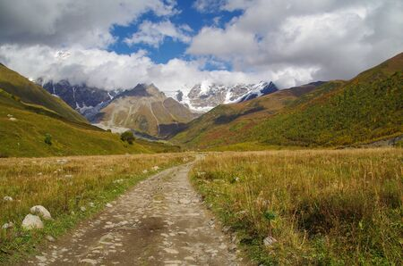 Autumn colors. Scenic view from the trek from Ushguli to Shkhara glacier. Nature and travel. Georgia, Svaneti region, Mestia Stok Fotoğraf