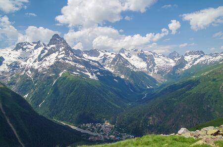 Dombay. Panorama of Greater Caucasus from the Mussa-Achitara mountain. Nature and travel. Russia, North Caucasus, Karachay-Cherkessia
