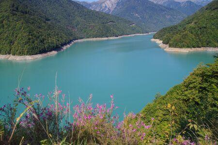 Beautiful landscape of the green-blue Enguri River. Nature and travel. Georgia
