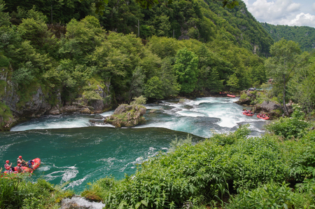 Rapids on the river Una. Natural landscape of exceptional beauty. Green spring blue color Bosnia and Herzegovina, Una National Park