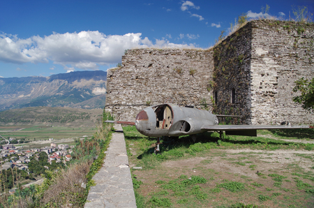 Scenic view of United States Air Force surveillance plane from the Castle fortification. Nature and travel. Albania, Gjirokaster - UNESCO World Heritage site