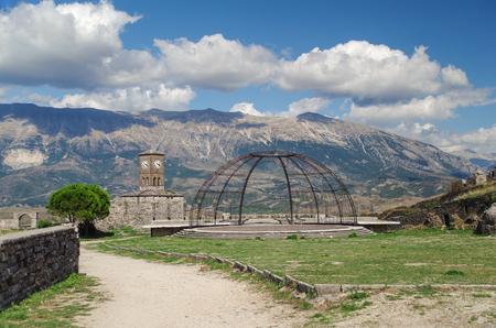 Gjirokaster Castle. Clock tower. Stage of the Gjirokaster national folklore festival. Albania, Gjirokaster - UNESCO World Heritage site