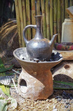Ethiopian cuisine. Jebena on coals. Used to brew coffee in the Ethiopian traditional coffee ceremony. Ethiopia, Amhara Region, Islands of Lake Tana
