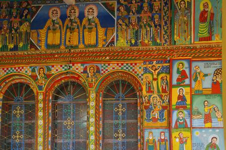 Exterior paintings. Christian murals on the walls. Illustrations of New Testament. Enda Iyesus Church. Ethiopia, Tigray Region, Maekelay Zone, Axum (Aksum) Standard-Bild - 132992638