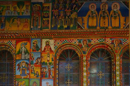Exterior paintings. Christian murals on the walls. Illustrations of New Testament. Enda Iyesus Church. Ethiopia, Tigray Region, Maekelay Zone, Axum (Aksum)