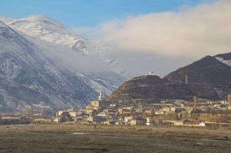 Winter morning in the ancient mountain village. Scenic view of Juma Mosque and Triumphal rotunda of Sharvili. Nature and travel. Russia, North Caucasus, Dagestan, Akhty Imagens