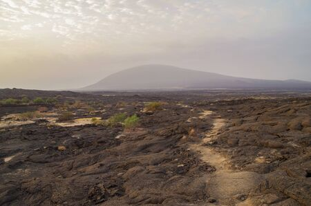 Sunrise. Beautiful view of stratovolcano Ale Bagu. Trek from Erta Ale across lava field to base camp. Ethiopia, Afar Depression (Afar Triangle or Danakil Depression)