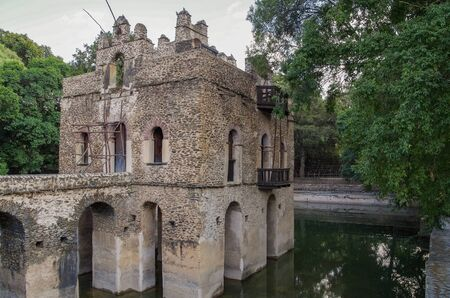 Fasilides Bath in Gondar. There is two-storeyed battlemented palace standing in square pool. Connected to the land by bridge. Here crowds gather to celebrate Timkat - Epiphany for Ethiopian Orthodox Tewahedo Church. UNESCO World Heritage Site. Ethiopia,