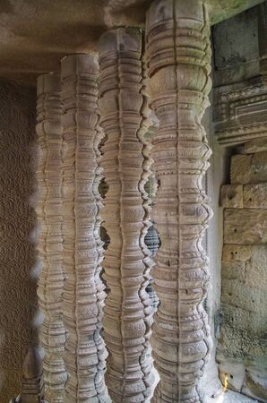 Carved sandstone spindles in a window. Mysteries of Angkor Wat. Angkor - UNESCO World Heritage site. Cambodia, Siem Reap, Angkor Wat