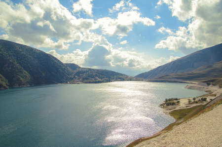 Deepest highland lake in the Caucasus Mountains. Scenic autumn landscape. Height 1870 m above sea level. Nature and travel. Russia, North Caucasus, on border of Chechnya and Dagestan, lake Kezenoyam